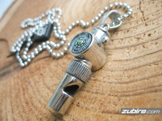 Necklace whistle with a compass
